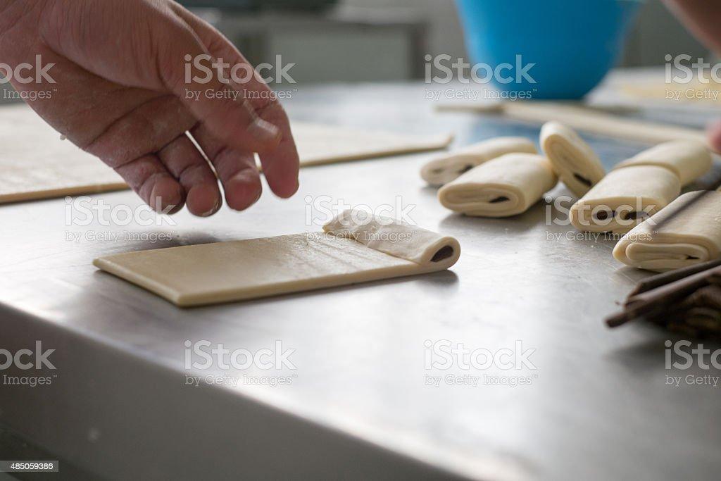 Baker Making Chocolate Pastries stock photo