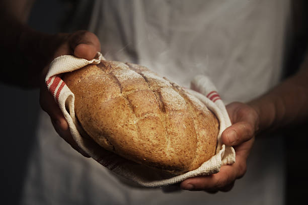 Baker man Baker man holding a warm bread baking bread stock pictures, royalty-free photos & images