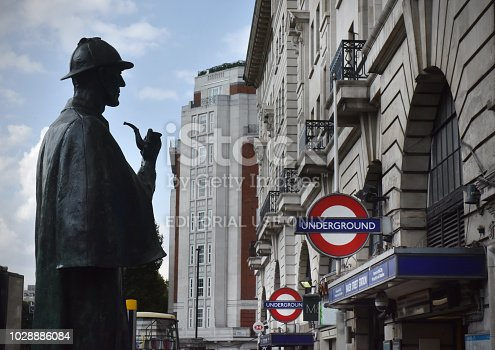 The public statue of fictional detective Sherlock Holmes (in semi silhouette) that stands outside Baker Street Underground (tube) station in London. In the detective novels created by author Sir Arthur Conan Doyle  - Holmes lived at 221b Baker Street