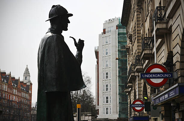 Baker Street Silhouette London, UK - April, 10th 2013:The public statue of fictional detective Sherlock Holmes (in semi silhouette) that stands outside Baker Street Underground (tube) station in London sherlock holmes stock pictures, royalty-free photos & images