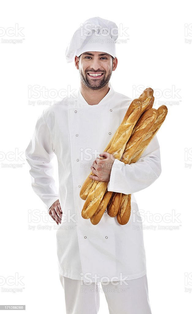 Baker With Fresh Bread Portrait of a male baker holding fresh baguettes, smiling at camera. 30-34 Years Stock Photo
