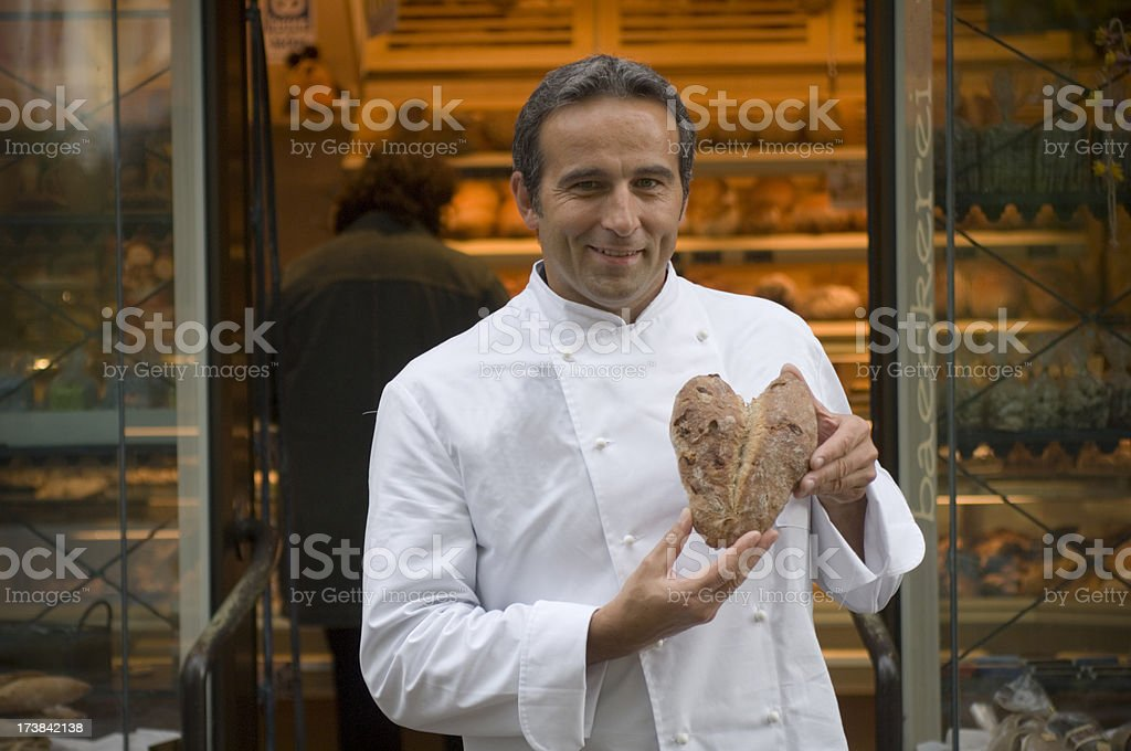 Baker with valentine bread royalty-free stock photo