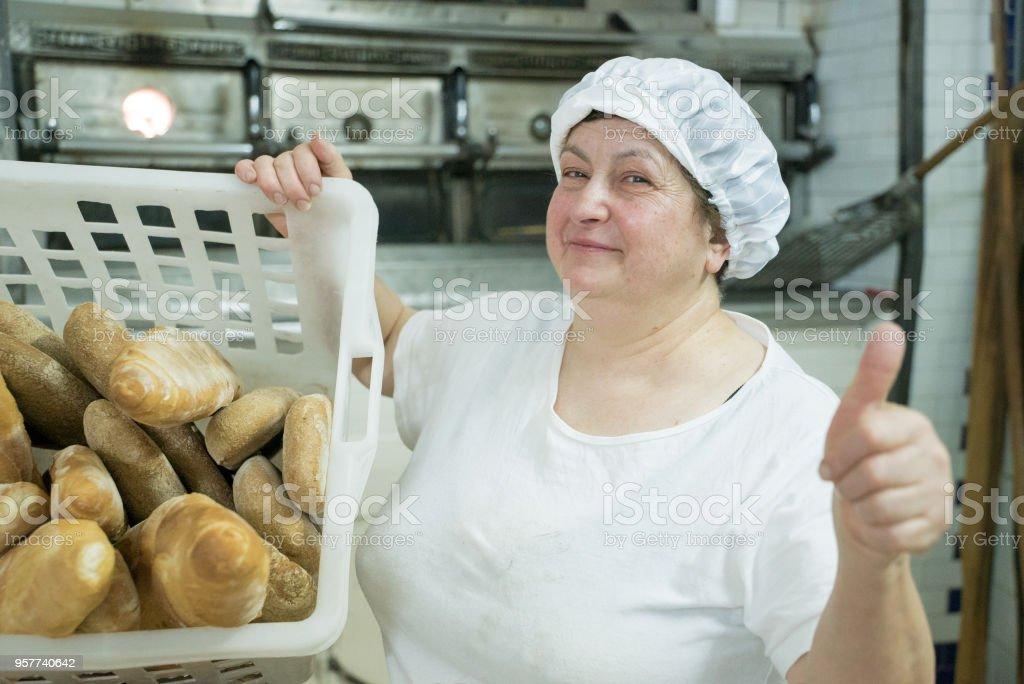 Baker working in a small Italian bakery. stock photo