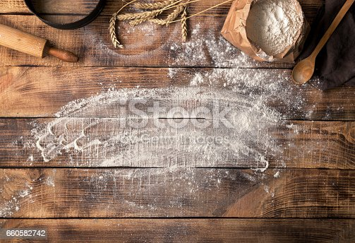 istock Baker workplace with flour, top view with copy space 660582742