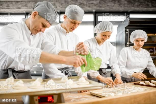 Bakers making buns at the manufacturing picture id968321928?b=1&k=6&m=968321928&s=612x612&h=rggapylpvnplibr76q612s8xtzf 4yjsg1yxpmvdbiq=