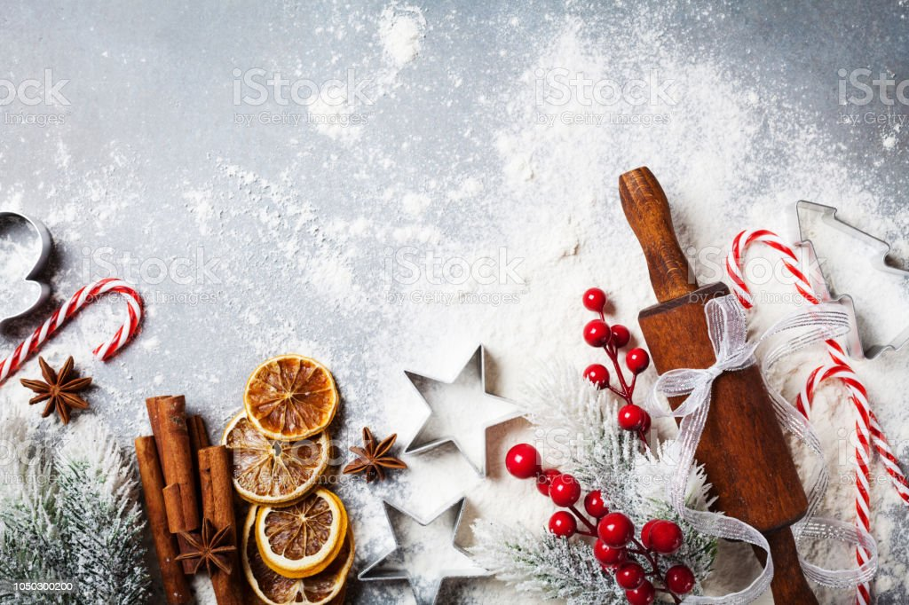 Bakery background for cooking christmas baking with rolling pin, scattered flour and spices decorated with fir tree top view. stock photo