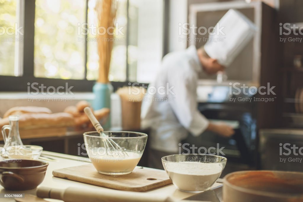 Bakery chef cooking bake in the kitchen professional stock photo