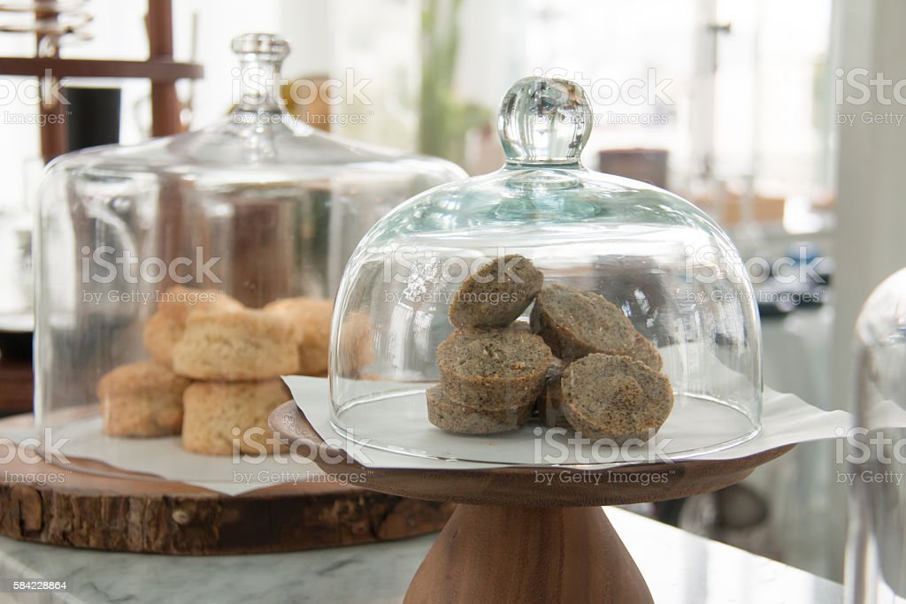 Bakery displayed in glass bell. stock photo