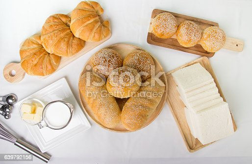istock Bakery milk woodentrey and equipment on white background 639792156