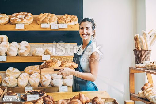 istock Bakery owner at the bread display 629554126