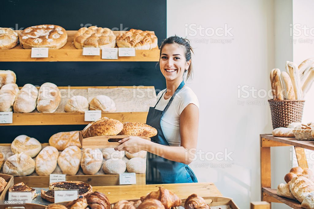 Bakery owner at the bread display - Photo