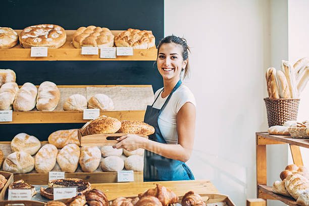 Bakery owner at the bread display stock photo