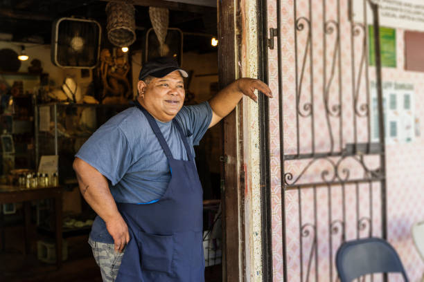 bakery owner posing with smile - guam foto e immagini stock
