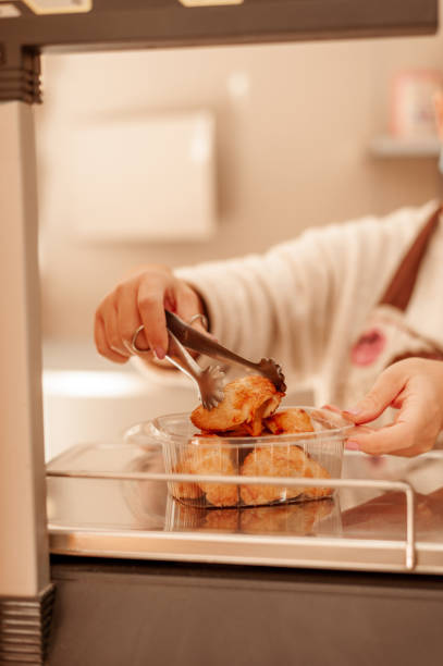 Bakery owner using weight scale. New normal concept. stock photo