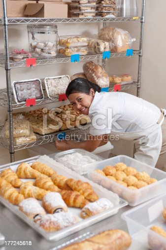 Charming baker tagging her bakery products