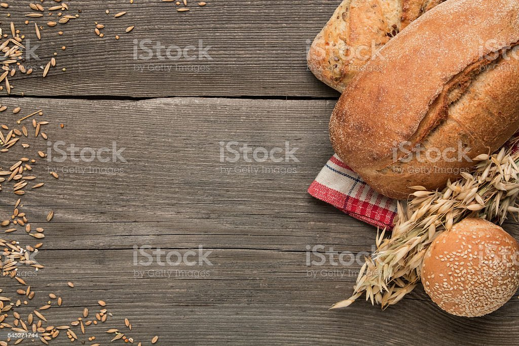 Bakery products on the dark wooden background stock photo