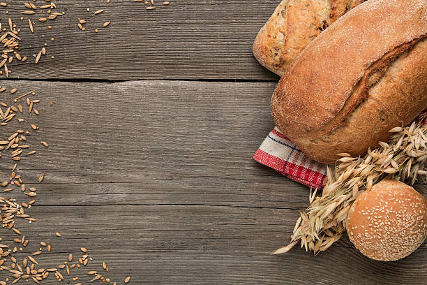 bakery products on the dark wooden background - brot kohlenhydrate stock-fotos und bilder
