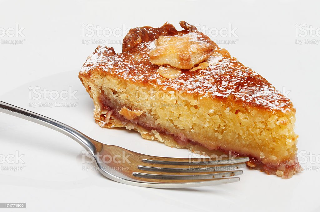 Bakewell tart and fork stock photo