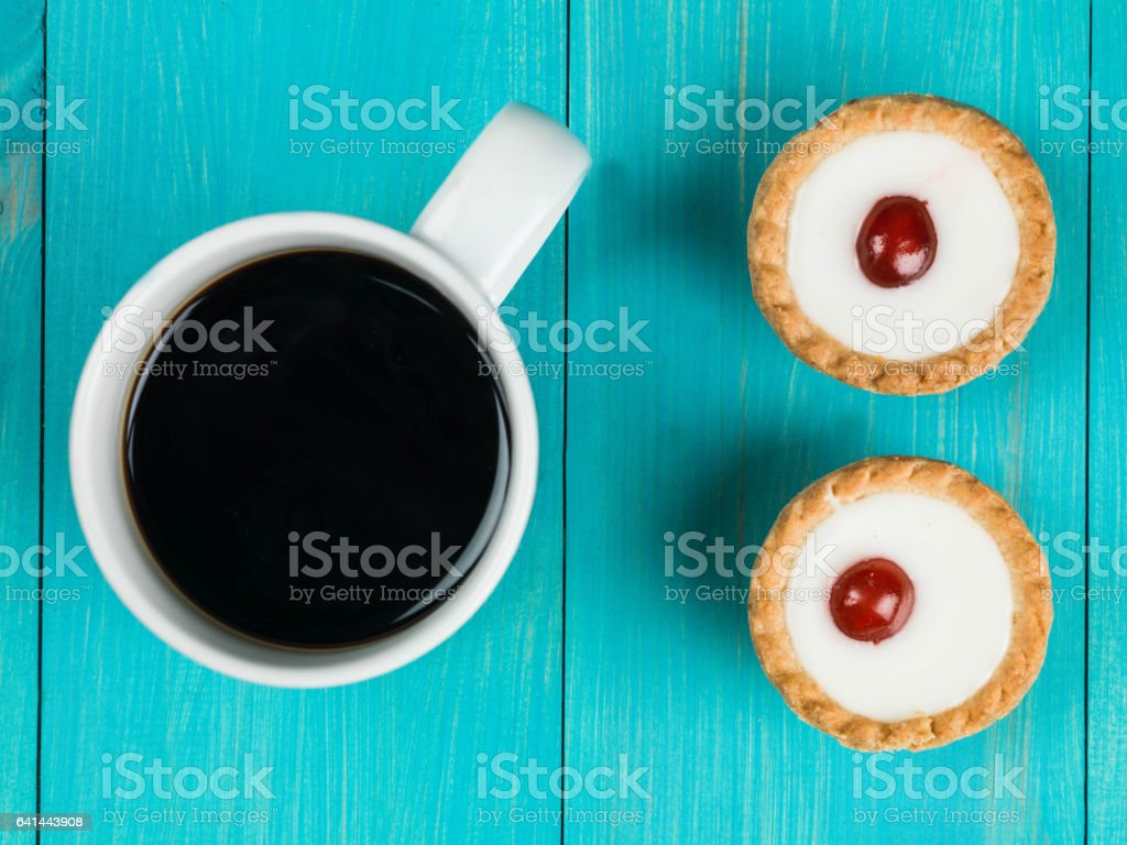 Bakewell Tarts With a Mug of Coffee stock photo