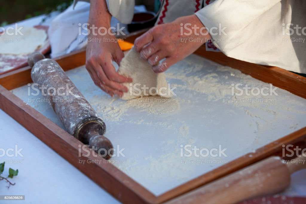Baking a fouace, a round and airy bread from the western France stock photo