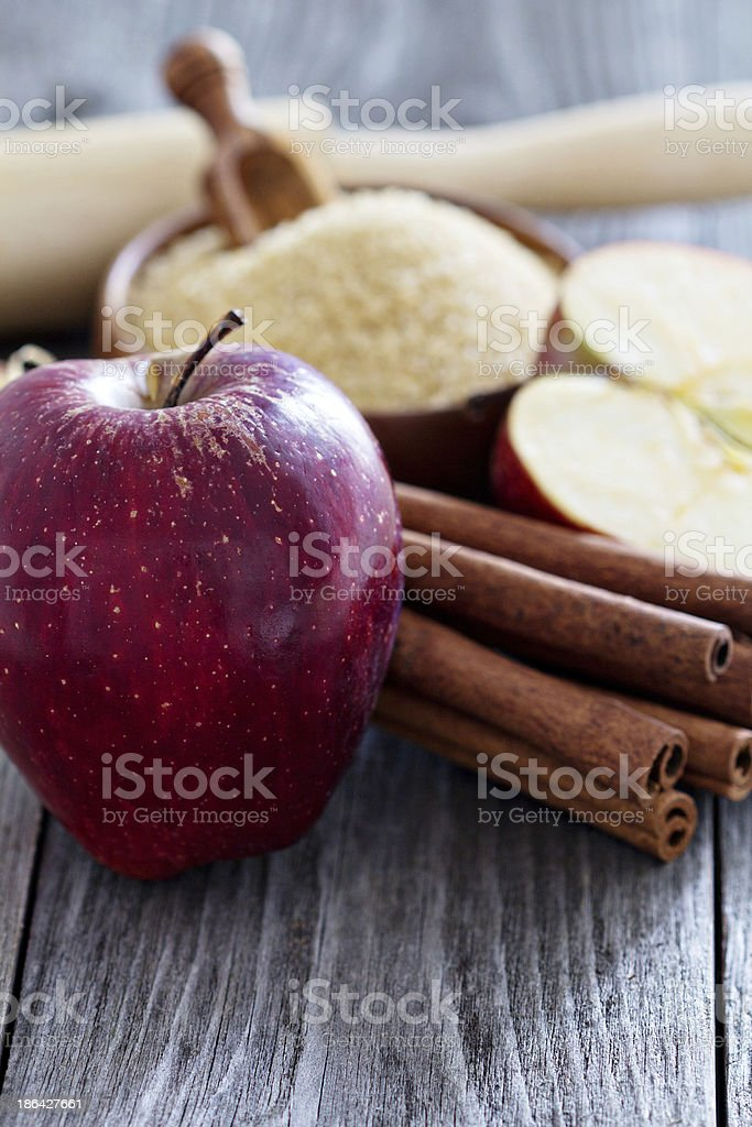 Baking a pie - apples, sugar and cinnamon royalty-free stock photo