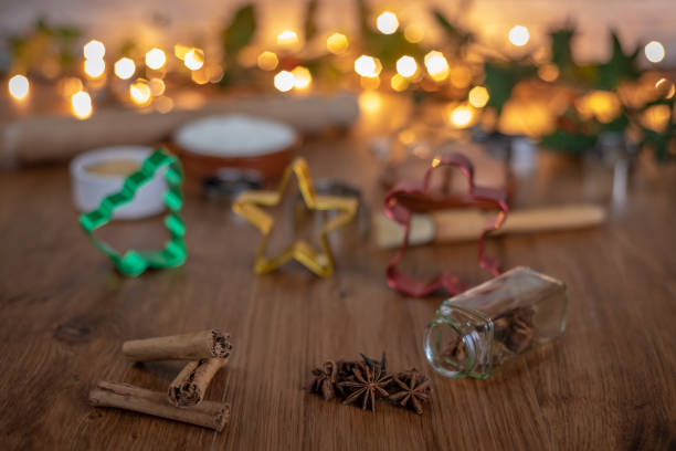 baking at christmas with cinnamon and star anise - christmas stock photos and pictures