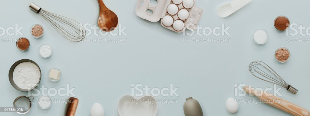 baking background with bake ingredients, banner for website on pastel background, top view, flat lay, copy space. Preparation Baking Kitchen Table Ware stock photo
