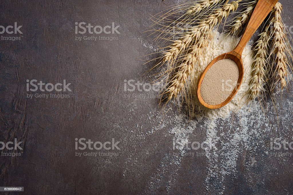 Baking background with dry yeast in a spoon stock photo