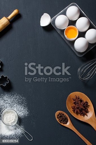 istock Baking background with eggs, floor and kitchen tools 630039254