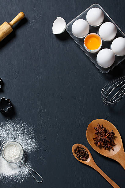 Baking background with eggs, floor and kitchen tools stock photo