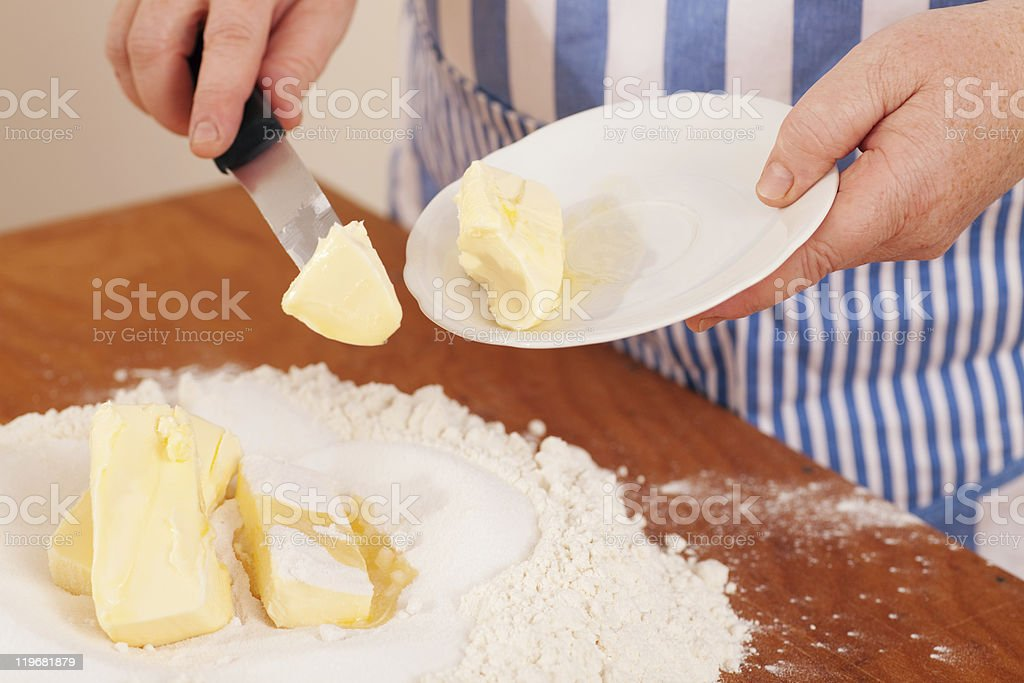 Baking biscuits - Woman mixes dough royalty-free stock photo