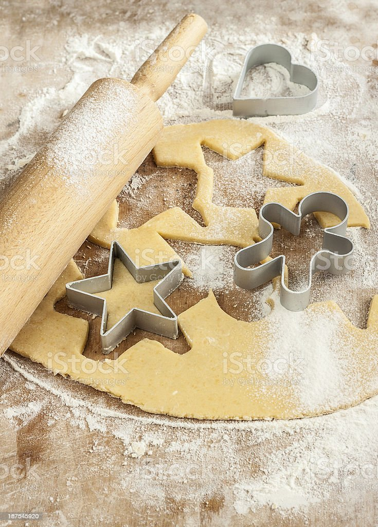 Baking christmas cookies - dough, cookie cutters and rolling pin stock photo