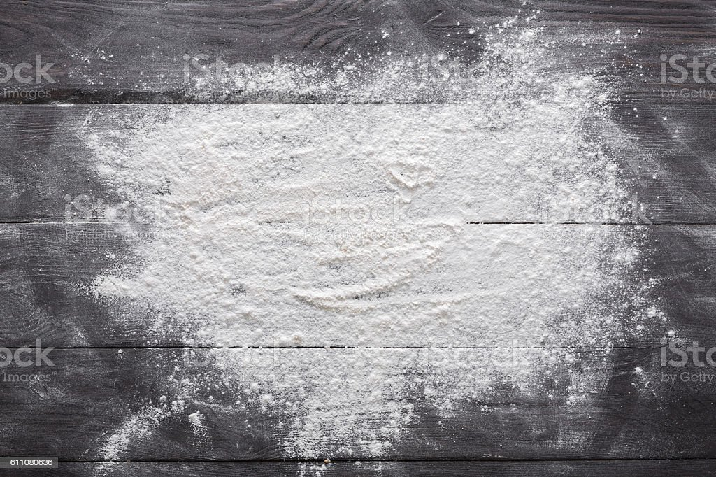 Baking concept on wood background, sprinkled flour with copy space stock photo