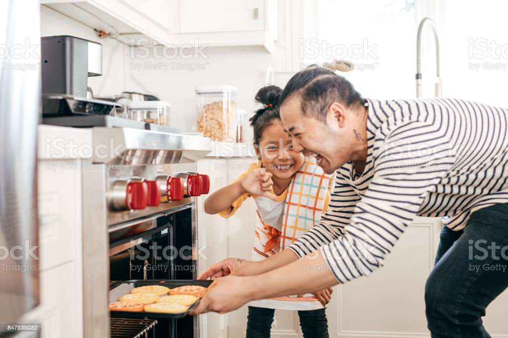 Backing cookies with dad stock photo