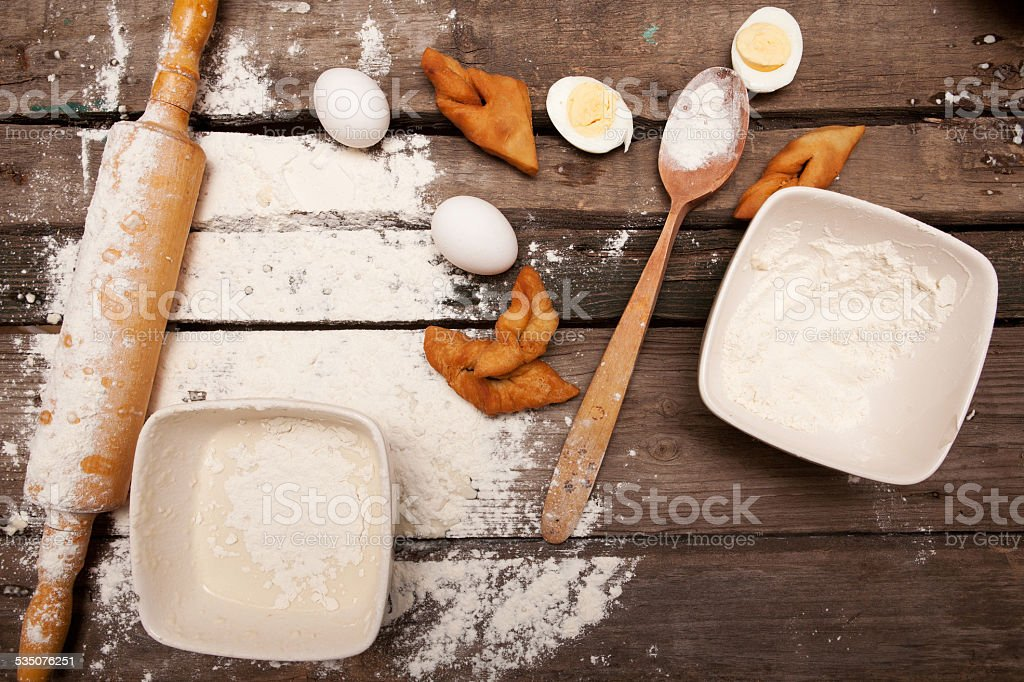 Baking, eggs, flour, plunger in rural kitchen  on wood table stock photo