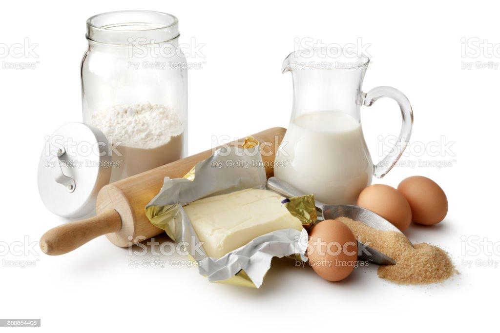 Cozimento: Farinha, manteiga, ovos, açúcar e leite, isolado no fundo branco - foto de acervo