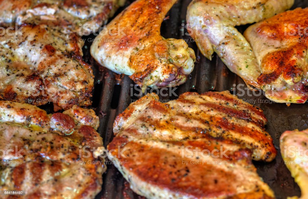 Baking fresh meat on grill foto stock royalty-free