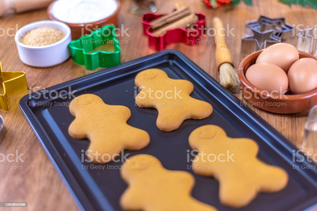 Baking Gingerbread characters at Christmas on a baking tray stock photo