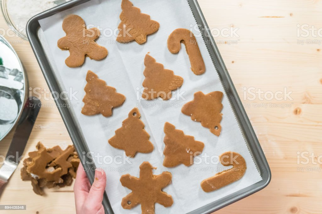 Baking gingerbread cookies for Christmas. stock photo
