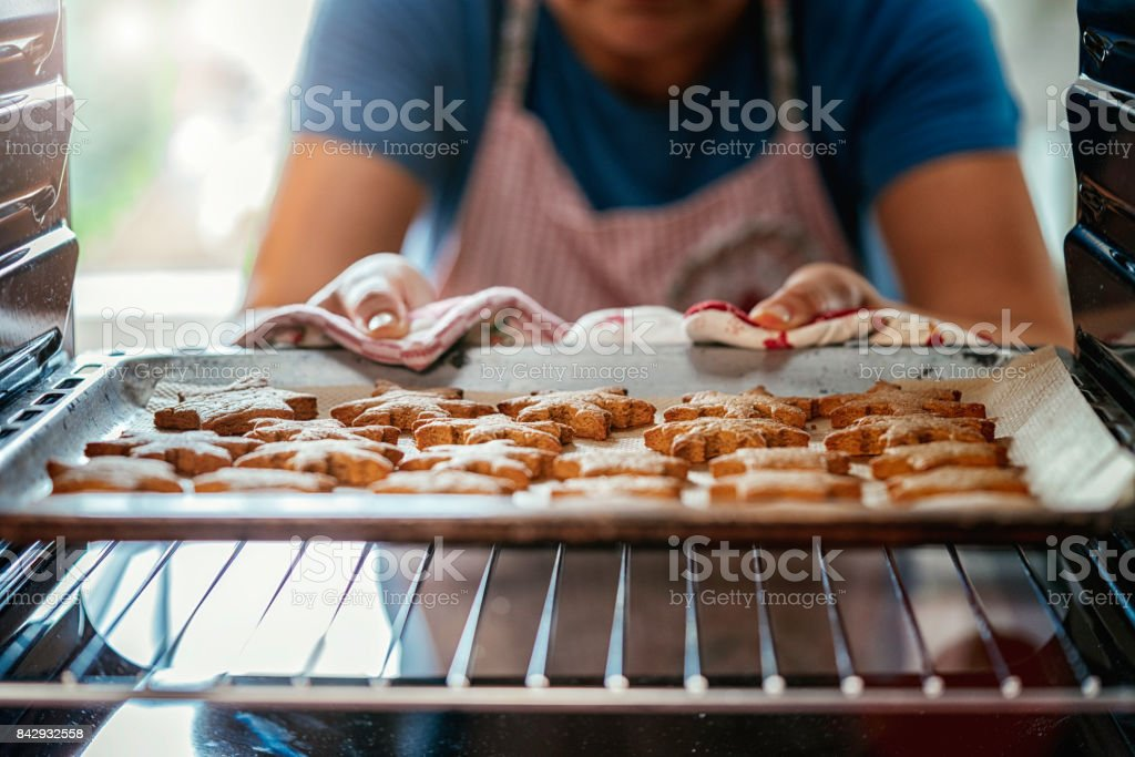 Baking Gingerbread Cookies in the Oven stock photo