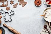 istock Baking gingerbread man Christmas cookies in kitchen 1255425049
