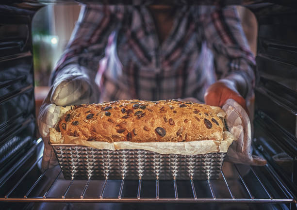 Baking Healthy Seed Bread in the Oven Baking Healthy Seed Bread in the Oven oven stock pictures, royalty-free photos & images