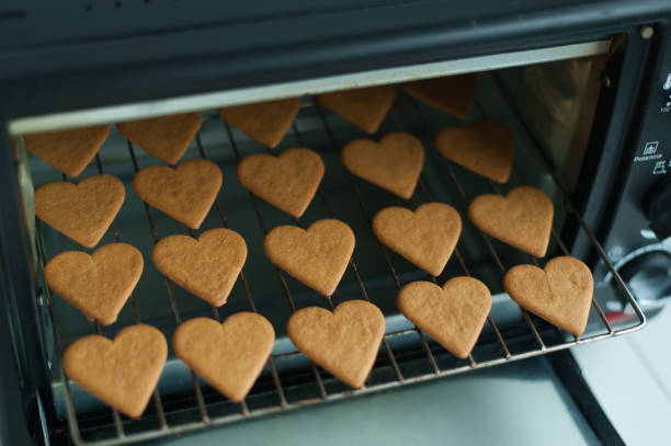 Baking heart shape cookies stock photo