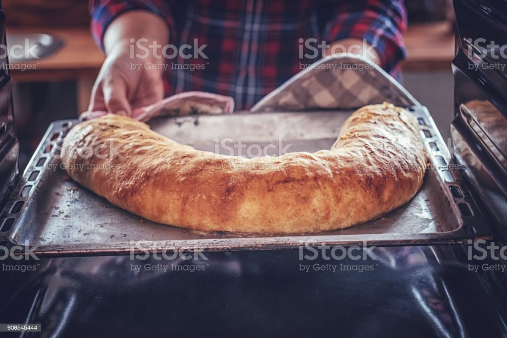 Baking Homemade Apfelstrudel in the Oven stock photo