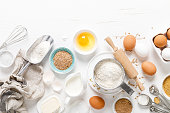 istock Baking homemade bread on white kitchen worktop with ingredients for cooking, culinary background, copy space, overhead view 1251084761