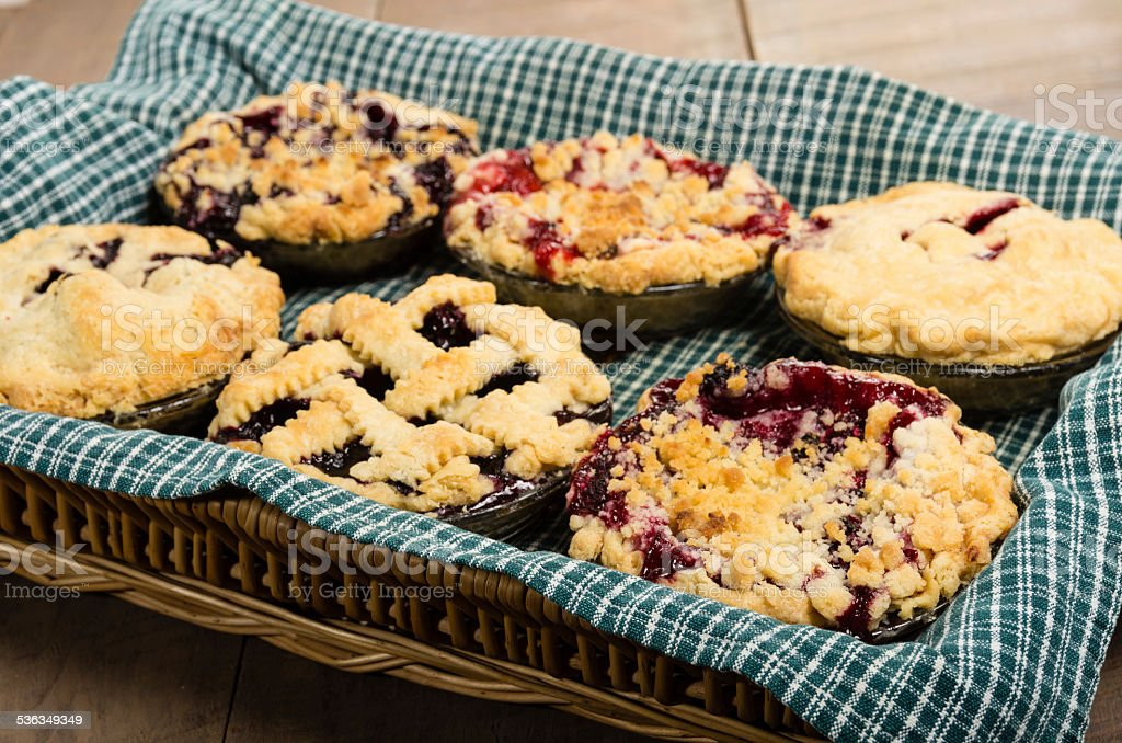 Baking homemade fresh fruit pies stock photo