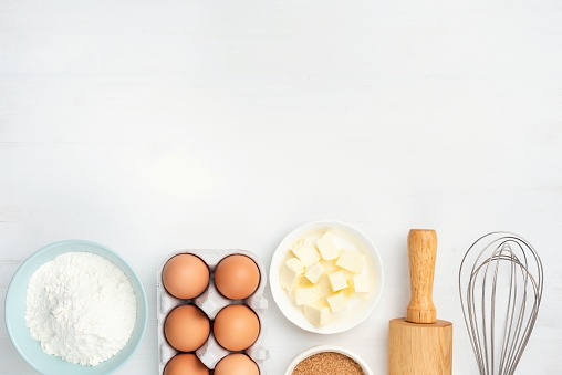istock Baking ingredients and kitchen utensils on white background 1135036976
