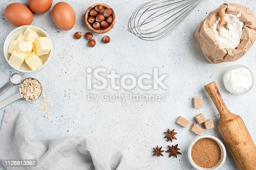 istock Baking ingredients and utensils on concrete background 1128813367