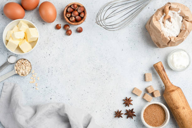 baking ingredients and utensils on concrete background - miele dolci foto e immagini stock