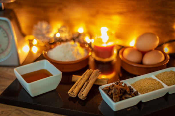 baking ingredients at christmas with cinnamon, eggs, star anise, sugar - christmas stock photos and pictures